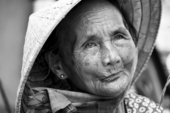 the face elderly w in hoi an white on rice couple vietnam travel essays