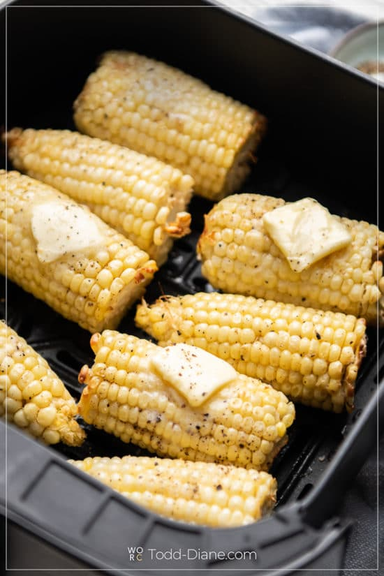Air Fryer Corn on the Cob in a basket up close