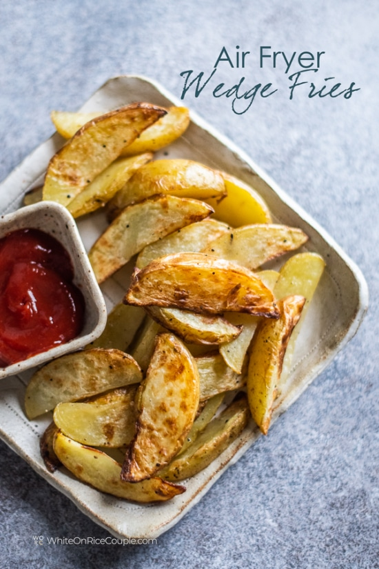 Plate of air fried French fries with side ketchup for dipping