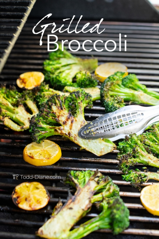 Grilled broccoli with lemon slices on grill