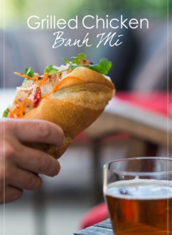 Hand holding Grilled Chicken Vietnamese Banh Mi by WhiteOnRicecouple.com