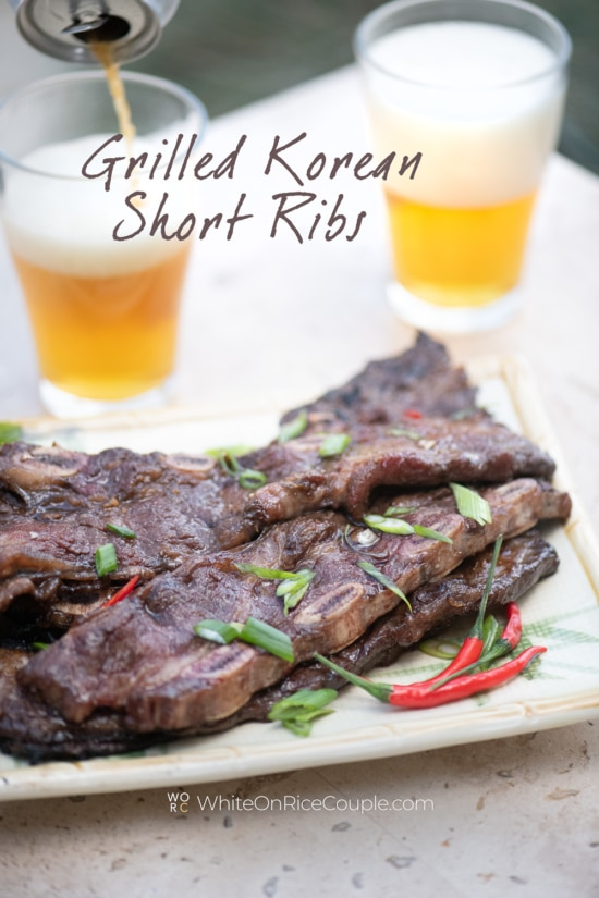 grilled Korean Kalbi short ribs served with beer by white on rice couple