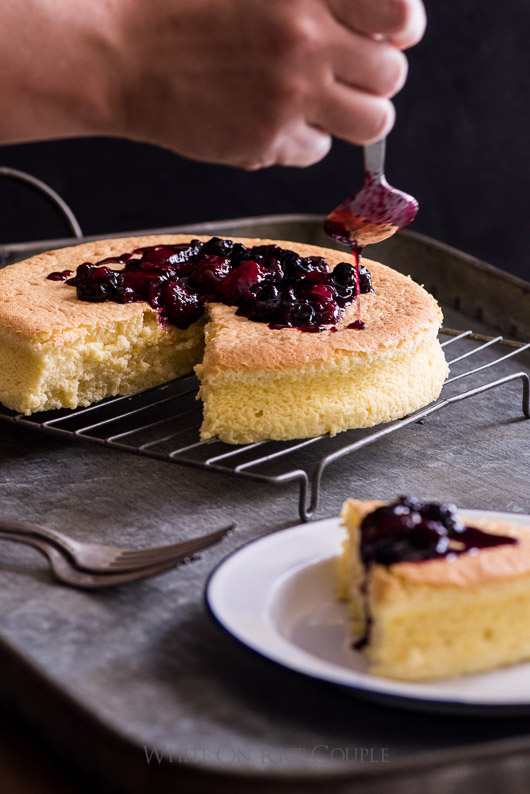 Fluffy and Soft Japanese Cotton Cheesecake Recipe with Berry Compote on a cooling rack