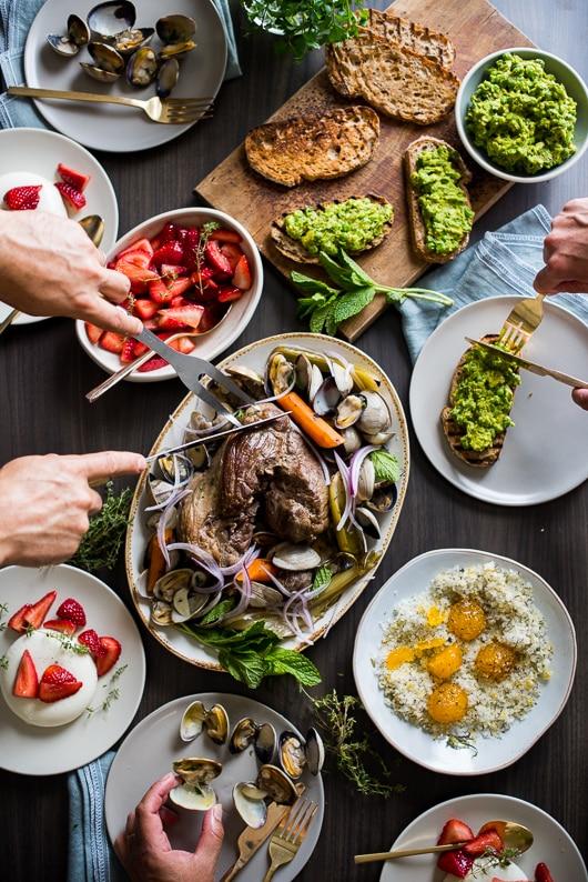 Roast lamb dinner with clams, avocado pea bruschetta and strawberry wanna cotta   @whiteonrice