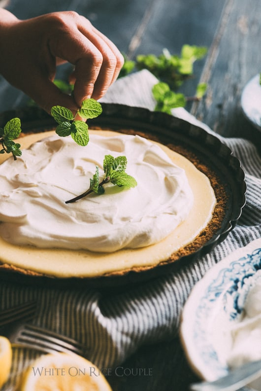 Meyer Lemon Pie fresh mint leaves being garnished over the pie