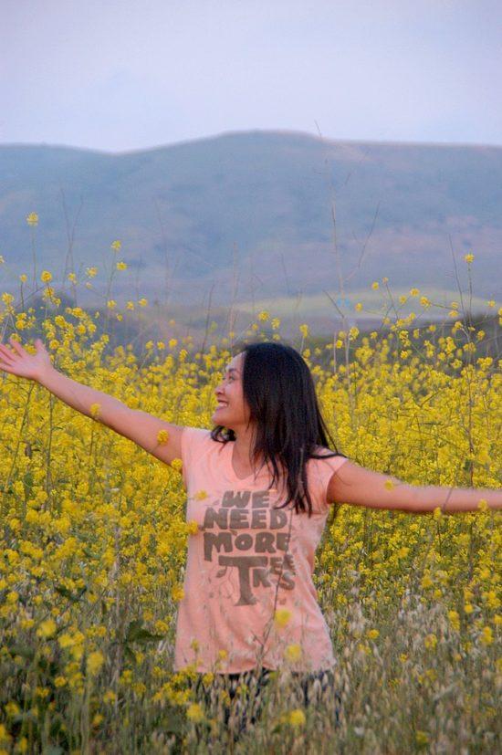 Diane in field of mustard greens | WhiteOnRiceCouple.com