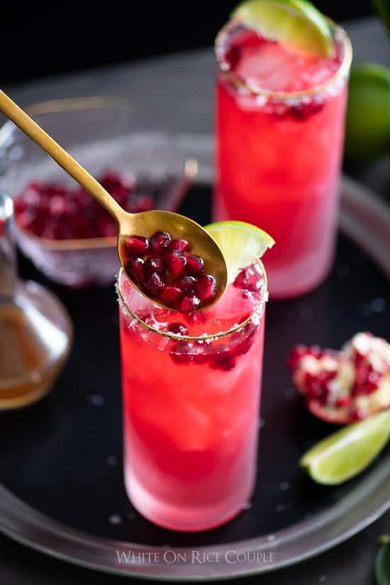 Pomegranate Margarita pouring pomegranate into glass