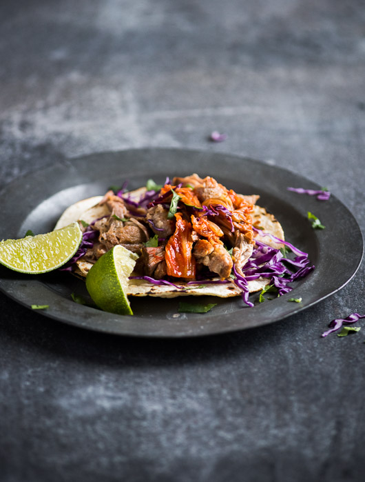 Pulled Pork Tacos with Kimchi on a plate