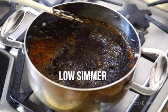 Simmering Thai tea mix with sugar in a pot