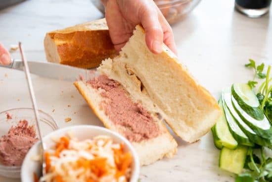 Spreading pate on sliced baguette