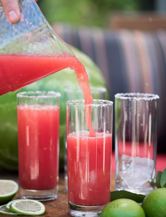 Watermelon Margaritas pouring into glass