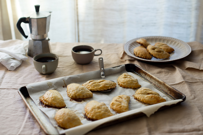 Brown Butter Apple Hand Pies on baking sheet
