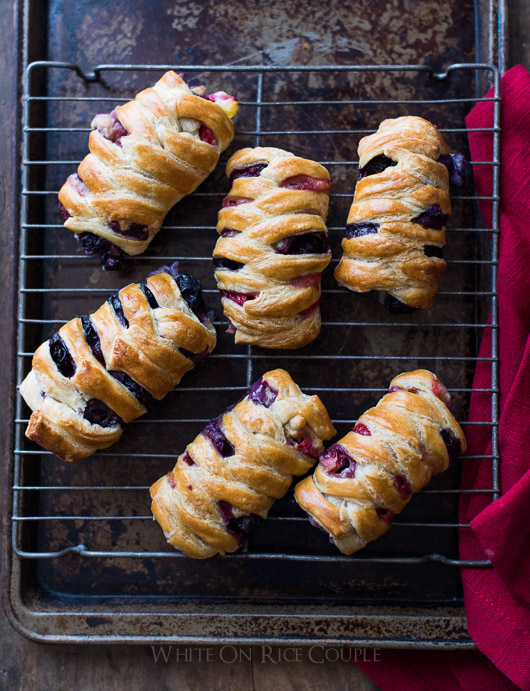 Homemade Strawberry/Blueberry Crossover Pastries on cooling rack