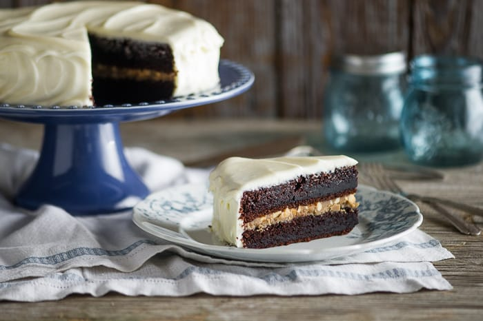 Black Magic Cake with Cream Cheese Frosting and Butterscotch filling on a plate