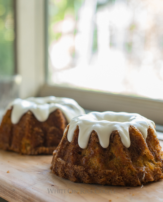 Tender and Moist Carrot Cake Recipe with Cream Cheese Frosting on a cutting board