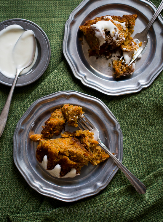 Tender and Moist Carrot Cake Recipe with Cream Cheese Frosting on a plate