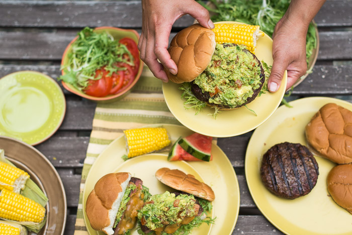 Jalapeño Cheddar Stuffed Burger and Chipotle Guacamole on a plate