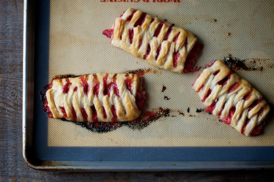 Berry puff pastry on baking sheet by whiteonricecouple.com