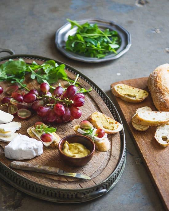 Easy appetizer recipe: Grape, Brie & Arugula Bruschetta on a cutting board