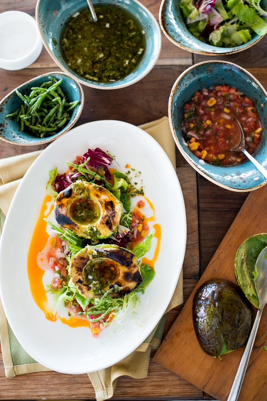 Grilled Avocado Salad with Corn Pico De Gallo and Chimicurri Dressing on a plate
