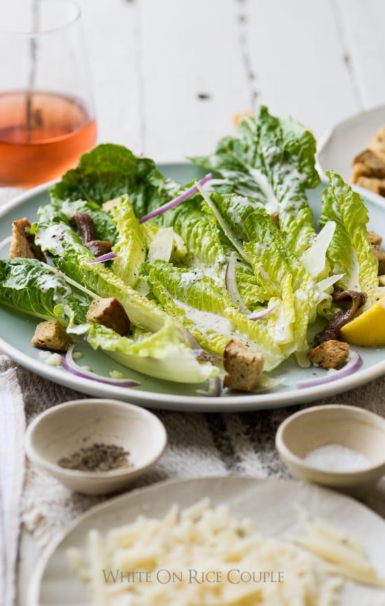 Homemade Caesar Salad Dressing and Caesar Salad on a plate