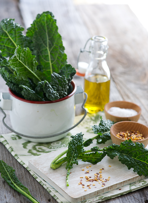 baked kale chips recipe on a cutting board