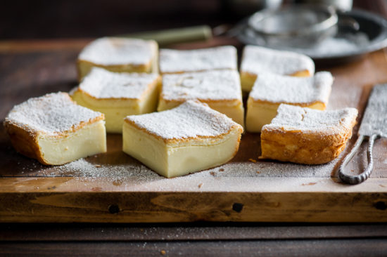 Magic Custard Cake Recipe on a cutting board close up