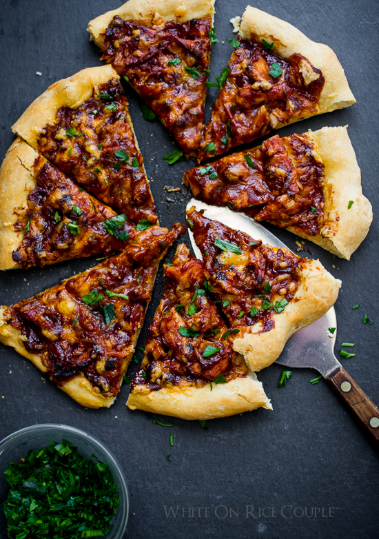 BBQ Turkey Pizza on a cutting board with a spatula