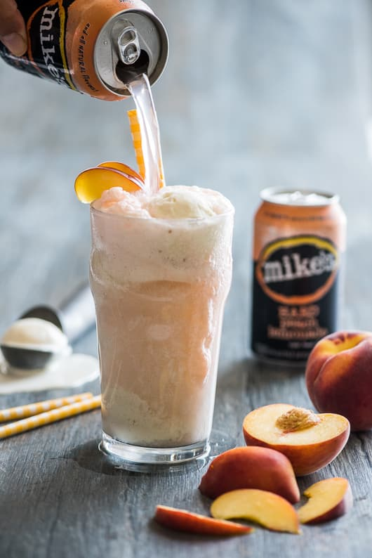 Boozy Peaches-n-Cream Ice Cream Float with Mike's Hard Peach Lemonade | @whiteonrice
