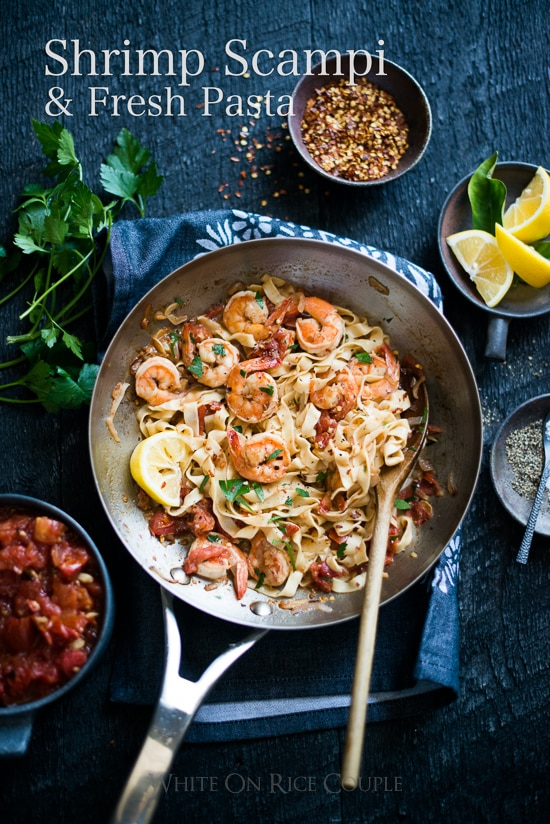 shrimp scampi with fresh pasta in a pan and ingredients