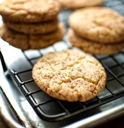 Soft, chewy and slightly crispy Snickerdoodle cookies on a cooling rack