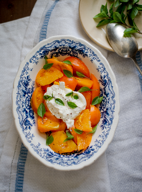 Tomato Salad Recipe with Burrata Cheese on a serving dish