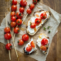 Grilled Cherry Tomato Skewers on Toast with Goat Cheese