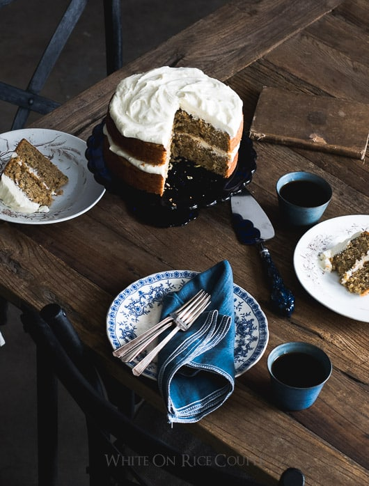 Olive Oil Zucchini Cake Recipe with Lemon Cream Cheese Buttercream Frosting on a serving platter